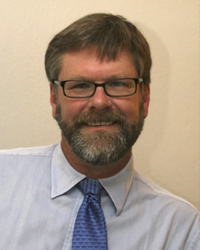 Dr. Charles  Layne