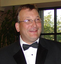 Dr. Mark  Clarke